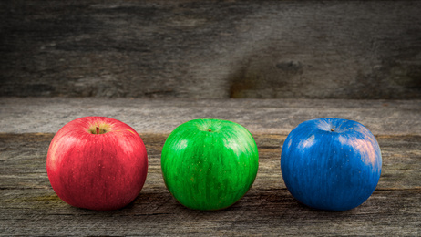 Three diverse apples: red, green and blue